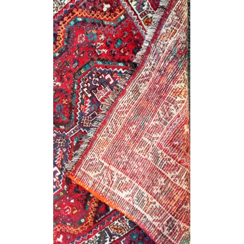 33 - A hand-knotted Baluch wool rug with double border, short fringe, in good condition, light wear, 175 ...