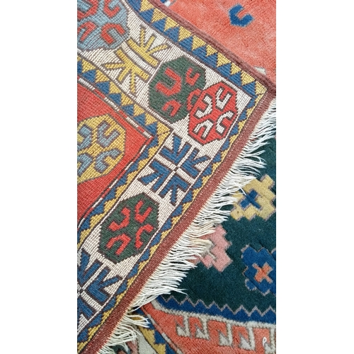 34 - A Baluch hand-knotted orange-ground wool rug with multi coloured isometric design, medium fringe, in...