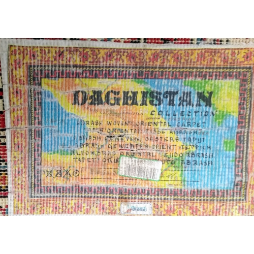 35 - An Oriental-style woven runner from the Daghistan Collection with multi coloured designs, 165 x 80 c...