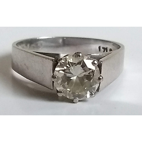 258 - A solitaire brilliant-cut diamond ring, approximately 0.75 carat on a white metal shank, stamped 18k...