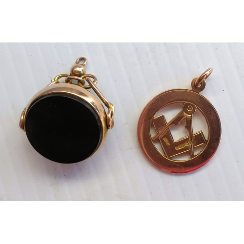 256 - An Edwardian bloodstone swivel fob, carnelian fob and a Masonic medallion, all hallmarked 9ct gold, ...