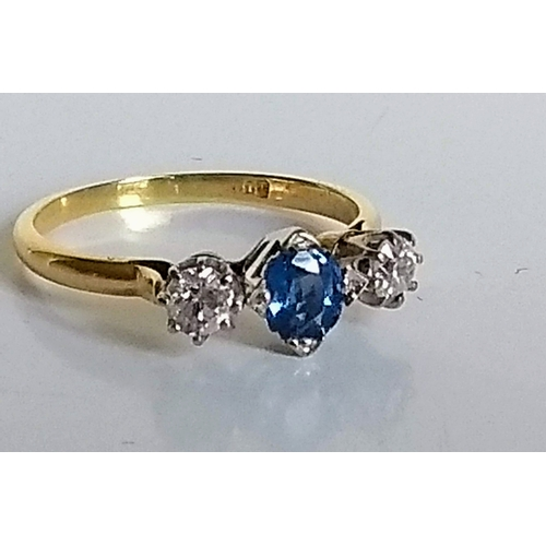 252 - A three-stone diamond and oval-cut sapphire ring in a cage setting, size T, stamped 18ct, 3.32g...
