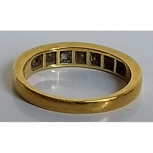 254 - A nine-stone half-hoop eternity ring with square-cut rubies and diamonds, size N, 3.7g...