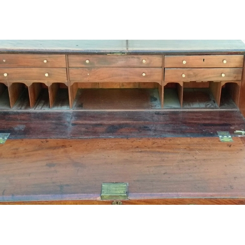 4 - A Georgian mahogany bureau with fitted interior over four graduated drawers with oval brass handles ...