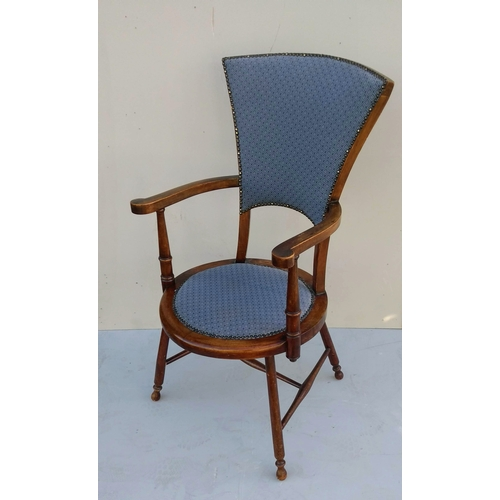 5 - An Arts and Crafts occasional chair with upholstered seat and stretcher support...
