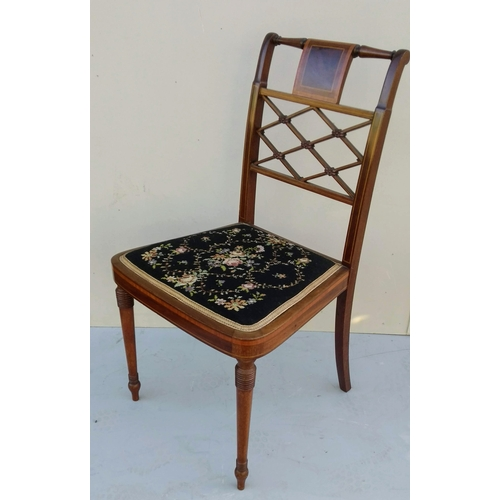 6 - A pair of Edwardian mahogany salon chairs with lattice supports, upholstered seats and all-over stri...