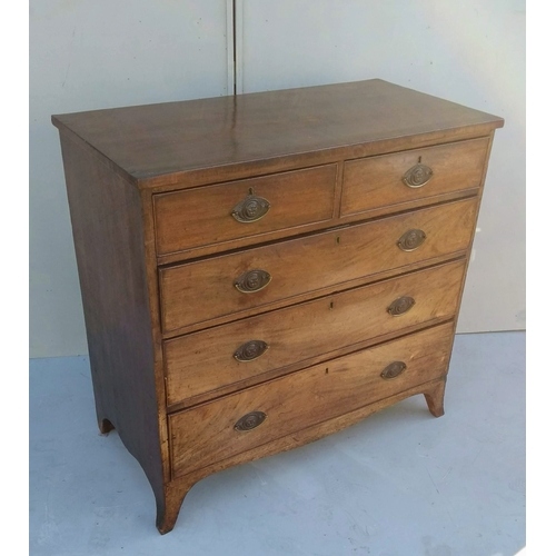 7 - A Georgian mahogany chest of two short and three long graduated drawers with later oval carved brass...