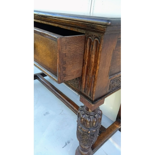 8 - An 18th century oak dresser base with moulded top, twin frieze drawers, arcading and carved decorati...