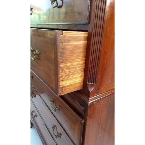 10 - A 19th century mahogany tallboy or chest on chest with dentil cornice, crossbanding and inlay decora...