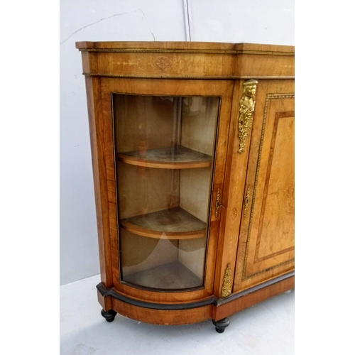 12 - A Victorian walnut credenza with bowed glass doors, central cupboard with marquetry and string inlay...