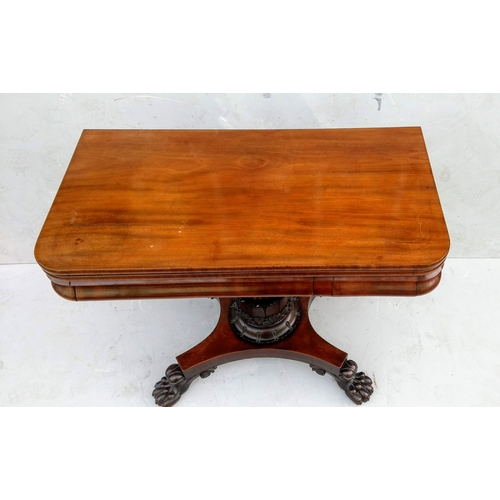 14 - A William IV mahogany fold-over card table with baize top, gun barrel support, finely carved lotus l...