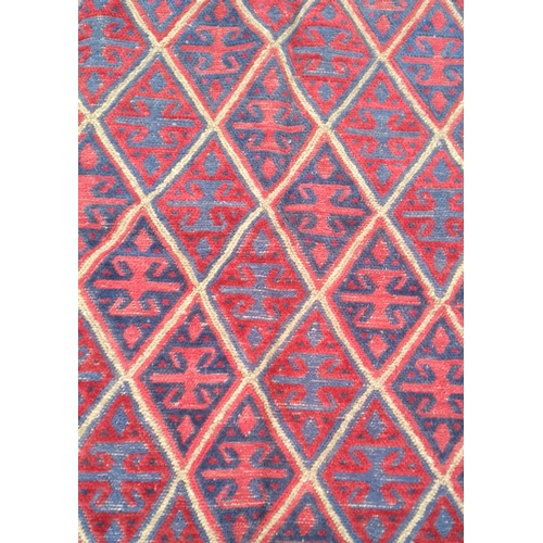 21 - A tribal Kazak hand-knotted wool rug with multicoloured isometric design, 125 x 118 cm in good condi...