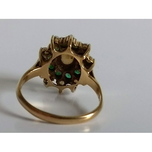261 - A Victorian opal and emerald cluster ring in a 9ct yellow gold cage setting and loop, size Q, hallma...