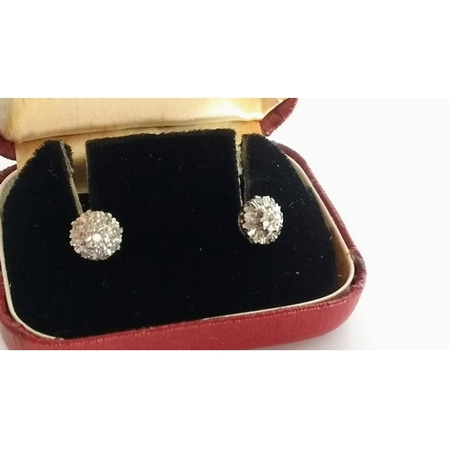 279 - A pair of diamond cluster earrings in a 9ct white gold setting, each 7mm diameter and a pair of pear...