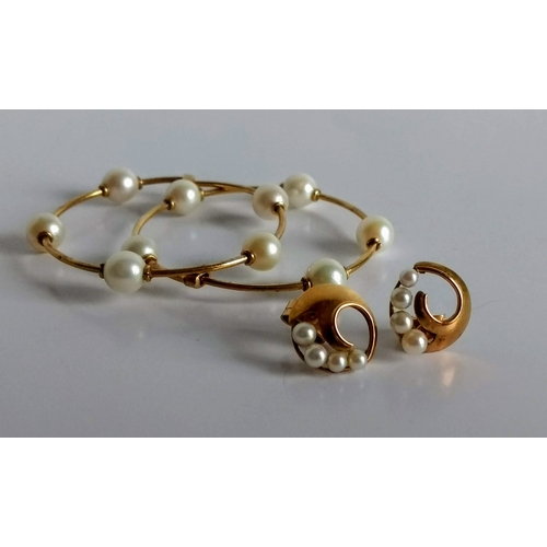 281 - A pair of yellow metal earrings each with four graduating pearls, stamped 18k, 12mm diameter and a p...