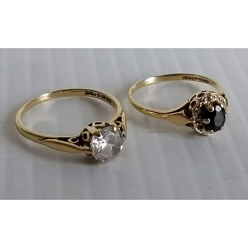 247 - A Victorian single stone ring in a 9ct yellow gold cage setting and another similar with an oval cut...