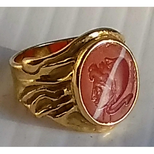 An intaglio panel ring set with carved cameo, 14mm x 11mm, stamped 750, size P, 8.11g