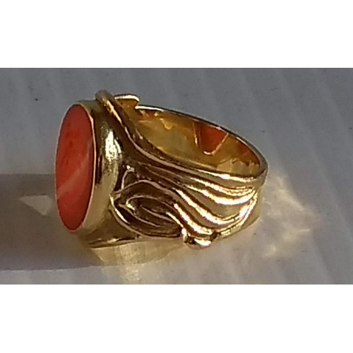 284 - An intaglio panel ring set with carved cameo, 14mm x 11mm, stamped 750, size P, 8.11g...