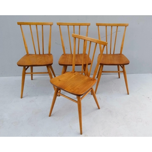 15 - A set of four 1960's Ercol elm and beech dining chairs with matching dining table, 73 x 100 x 70 cm...