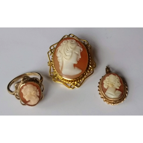 243 - A 9ct yellow gold filigree cameo brooch, 35mm x 28mm, similar ring, size L and pendant, 11mm x 8mm, ...