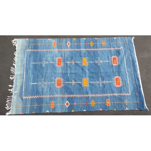 22 - A Moroccan indigo flat woven wool kilim with multi-coloured isometric decoration, 195 x 313 cm, in v...