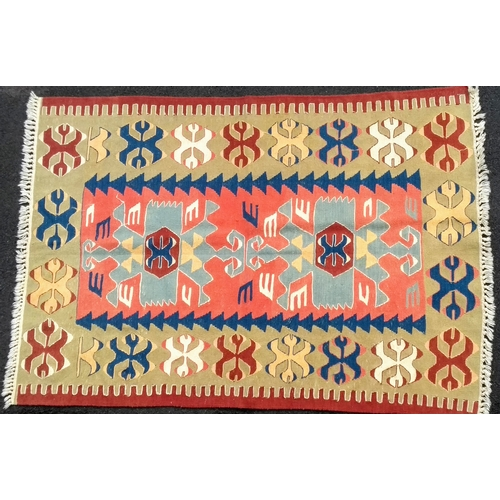 24 - An ivory-ground Turkish flat weave wool kilim with multi-coloured decoration, 172 x 120 cm in very g...