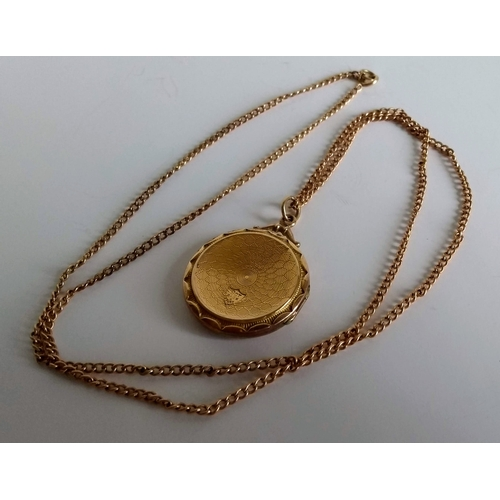 269 - An 18ct gold neck chain, stamped, 6.4g and a 9ct gold back/front locket, 4.4g...