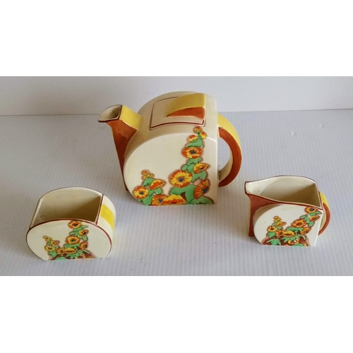 60 - A Clarice Cliff Sunshine pattern Stamford teapot, milk and sugar circa 1931, transfer printed and pa...