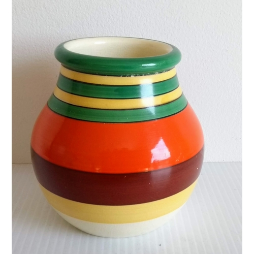 61 - Two Clarice Cliff Bizarre side plates in the 'Bignou' pattern and a multi-coloured honey pot with Fo...