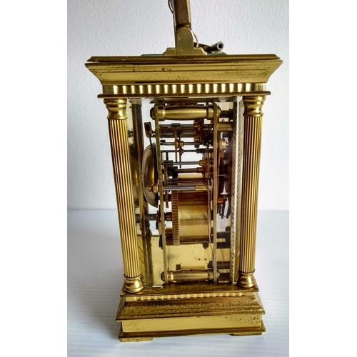 48 - A brass carriage clock by Charles Frodsham, London, circular white dial with Roman numerals with a g...