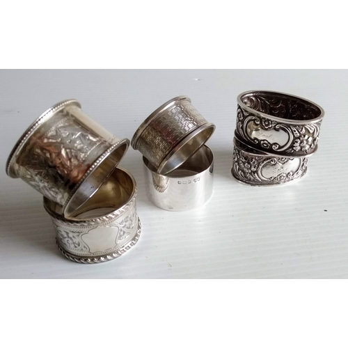 Six silver napkin rings, two pairs, one pair with vacant cartouche, mixed dates, 140g (6)