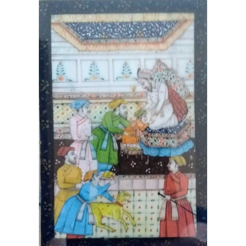 20 - A miniature Indian mughal court scene painted on ivory, framed and mounted, unsigned, 10 x 7 cm, fox...