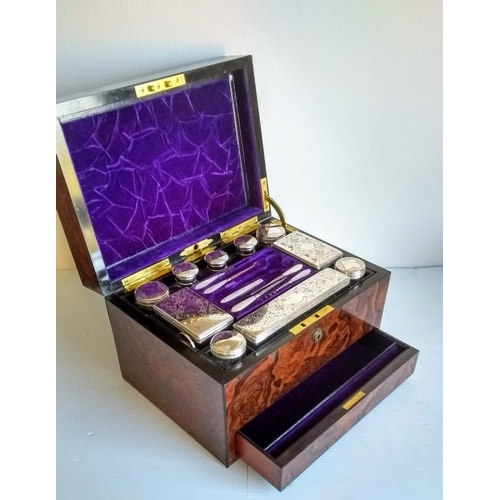 100 - A Victorian burr walnut vanity box with lift-out ten silver plate-topped bottles and jars, concealed...