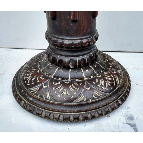26 - An Arts & Crafts mahogany jardiniere or candle stand with rope-twist column and carved decoration to...
