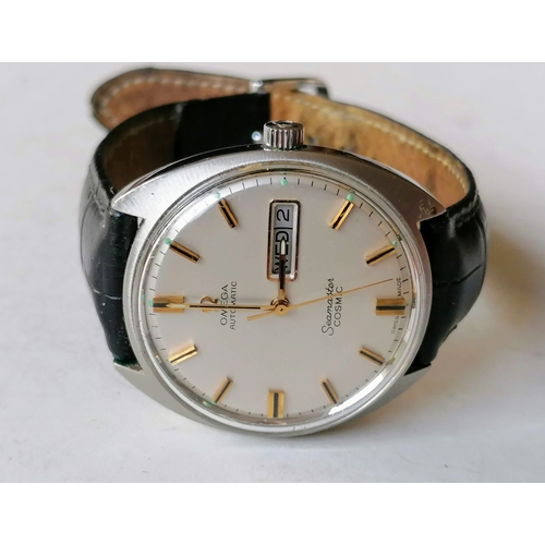 7 - A vintage Omega Automatic Seamaster Cosmic, stainless steel case, numbered 166036 tool 107, cream di...