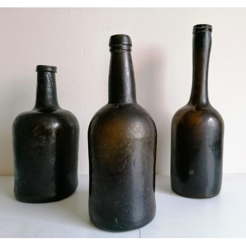 52 - Three olive green onion-shape bottles, one other lighter green, another with slight iridescence and ...