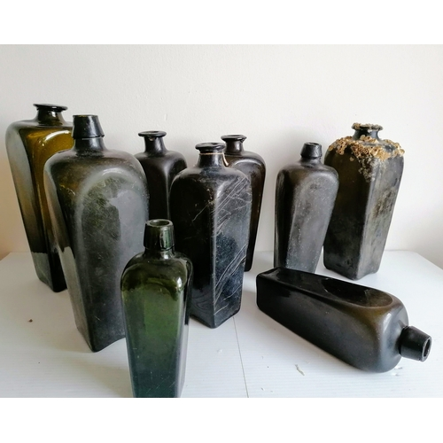 53 - Nine 18th and 19th century Dutch green glass gin bottles, shortest 18.5 cm, tallest 28 cm, one with ...