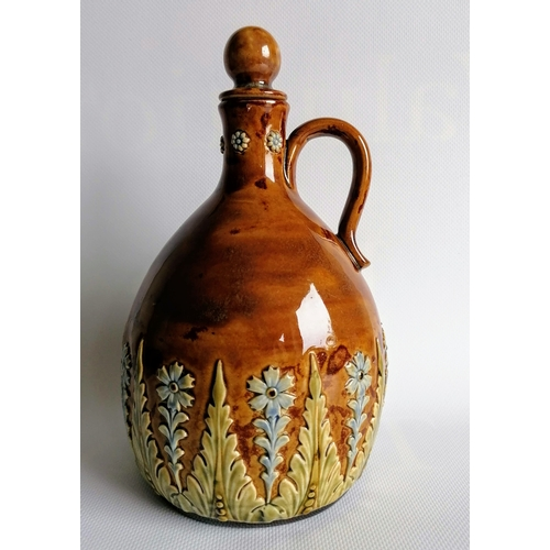54 - An Edwardian Royal Doulton Lambeth whisky jug with stopper in mottled tan-ground with floral and fol...