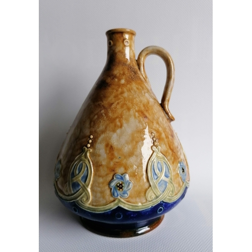55 - A George V Doulton Lambeth whisky jug with mottled tan-ground and Celtic knot decoration, c.1929, im...
