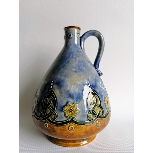 56 - An Edwardian Doulton Lambeth whisky jug with mottled blue-ground and Celtic knot decoration, impress...