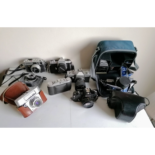 79 - An assortment of vintage cameras to include: a Petri Flex 7 automatic SRL camera with accessories, P...