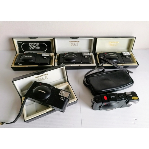 80 - Five Olympus XA2 range finder 35mm compact cameras, detachable flash, produced 1980 - 1986. Four wit...