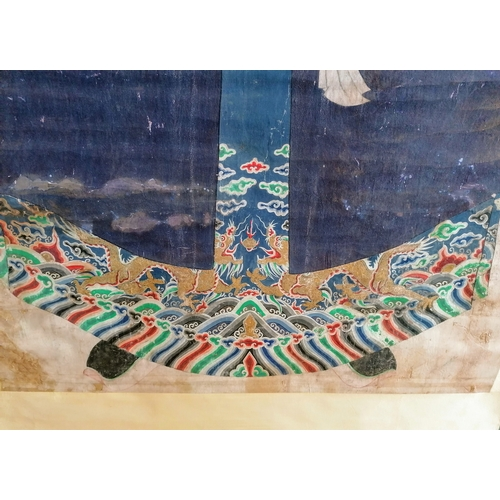 38 - A Qing dynasty Chinese batik ancestral or immortal portrait set on a paper scroll, (208 x 93 cm exte...