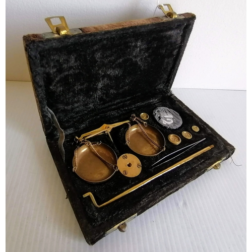 83 - A cased panned jeweller's weighing scales...
