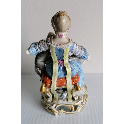 71 - A 19th century Meissen figurine of a seated lady feeding a cat, 13.5 cm H, without visible damage or...