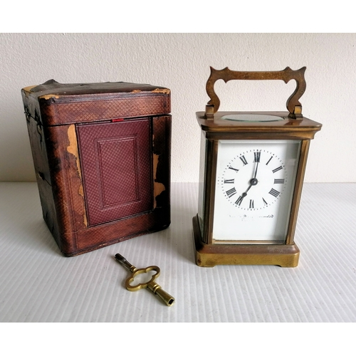 13 - A  recently serviced 19th century brass and bevelled glass cased carriage clock by Duverdry and Bloq...