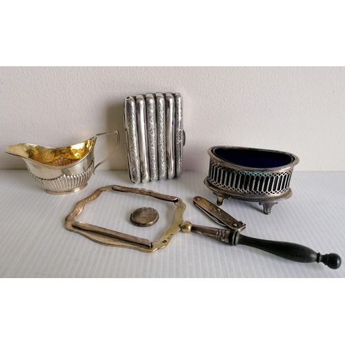 An Edwardian silver cigarette case of ribbed form by Albert Jackson, Birmingham, 1903, a smaller cream jug, oval salt with blue glass liner, picture frame, penknife and pendant, all hallmarked (6)