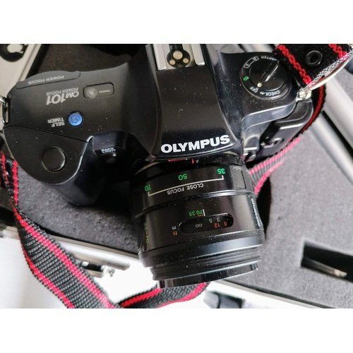 75 - A cased OLYMPUS OM101 POWER FOCUS SLR CAMERA with accessories, lock to case faulty...