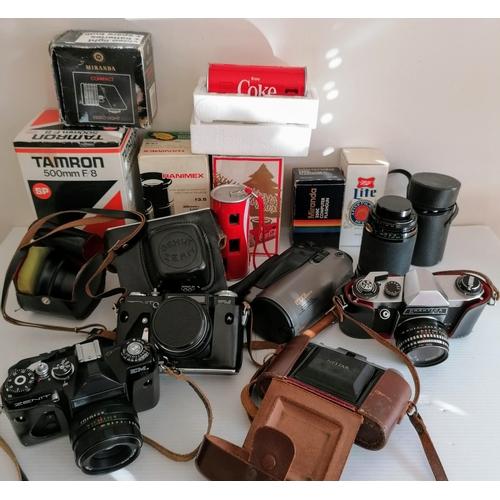 76 - Two Zenit EM Analogue Cameras with lenses, one Olympic Edition; a Praktica PL nova I; a Zeiss ikon n...