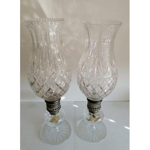 72 - A pair of Thomas Webb tulip-shape diamond-cut crystal glass candle holders, each 41 cm H...
